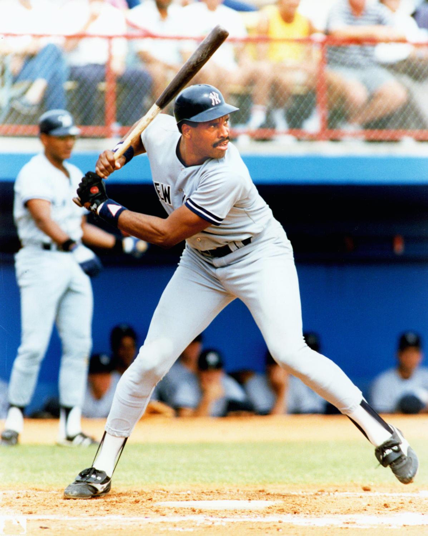 Full length color action batting portrait of Hall of Famer, David Mark 'Dave' Winfield, New York Yankees, road uniform c. 1981-88.